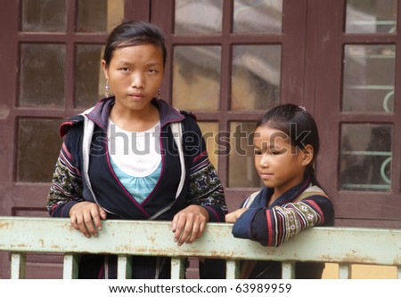 SAPA, VIETNAM - SEP 16: unidentified H'mong women in SaPa, Vietnam Sep 16 2010. According to CIA, the school life expectancy in Vietnam (primary to tertiary education) is 10 years (16 in the US)
