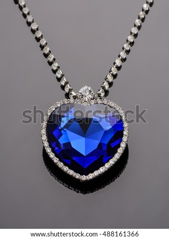 Sapphire pendant. Heart of the ocean. On mirror surface