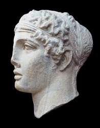 Sappho - ancient Greek lyric poet, side view, Istanbul museum. Portrait of Sappho, classic woman profile isolated on black background.