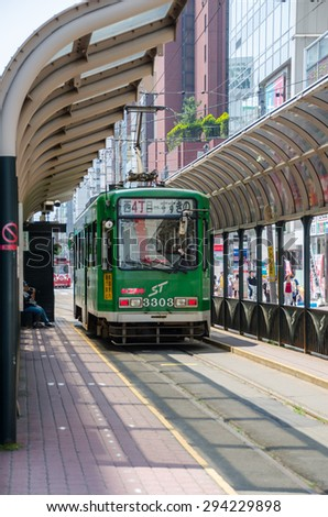SAPPORO, JAPAN - JUNE 16, 2015 : Sapporo street car at the station on June 16, 2015. Sapporo street car is a tram network since 1909, located in Sapporo, Hokkaido, Japan.