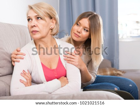 Sappy daughter supports her elderly mother in a difficult moment