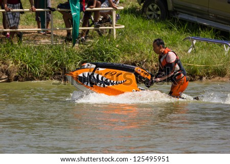 SARABURI THAILAND-JANUARY 20: Boonlue Korbangyang in action during show Freestyle the Jet ski  stunt action  on Jan 20, 2013 in SARABURI,Thailand.