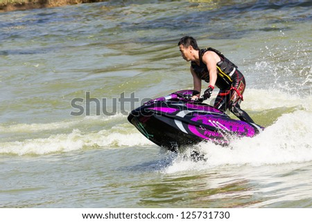 SARABURI THAILAND-JANUARY 20: Somchai Sae-Tang in action during show Freestyle the Jet ski  stunt action  on Jan 20, 2013 in SARABURI,Thailand.