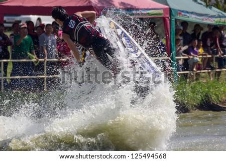 SARABURI THAILAND-JANUARY 20: Sonswut Rappasubpisan in action during show Freestyle the Jet ski  stunt action  on Jan 20, 2013 in SARABURI,Thailand.