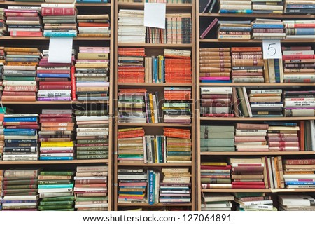 SARAJEVO, BOSNIA - AUGUST 11: Bookshelves on street market on August 11, 2012 in Sarajevo, Bosnia. Outdoor book markets are common occurrence in the cultural city of Sarajevo. - stock photo
