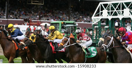 SARATOGA SPRINGS - August 7: Close up of the Starting Gate Showing Horses Breaking From The gate at the start of the Fourth race August 7, 2008 in Saratoga Springs, NY.