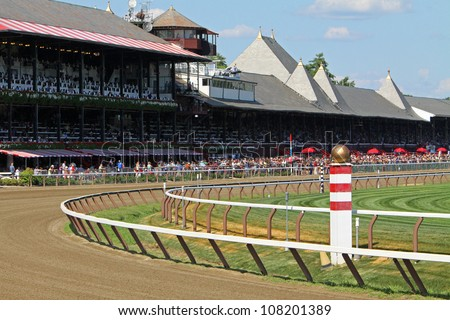 SARATOGA SPRINGS - JUL 21: Fans crowd historic Saratoga Race Course on Coaching Club American Oaks Day on Jul 21, 2012 in Saratoga Springs, NY.