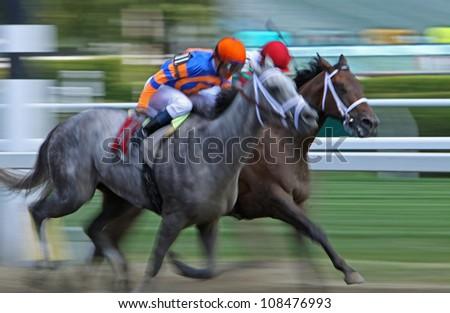 "SARATOGA SPRINGS - JUL 21: Jockey Javier Castellano (orange cap) pilots ""how Do I Win"" to a 3rd place finish in a claiming race on Jul 21, 2012 in Saratoga Springs, NY."