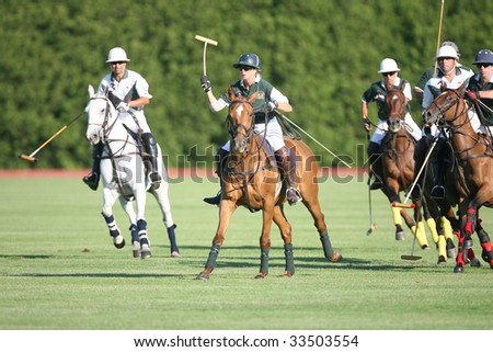 SARATOGA SPRINGS - JULY 10: L. Peters leads the action down the  field during the opening match of the season at Saratoga Polo Club July 10, 2009 in Saratoga Springs, NY.