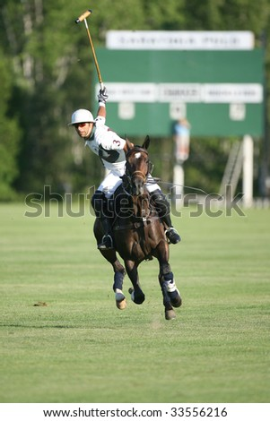 SARATOGA SPRINGS - JULY 10: Louis Galvan takes a shot in the opening match of the season at Saratoga Polo Club July 10, 2009 in Saratoga Springs, NY.