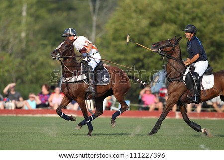 SARATOGA SPRINGS, NY - AUGUST 24: Unknown players in polo during the Ylvisaker Memorial Tournament at Saratoga Polo on August 24, 2012 at Saratoga Springs, New York