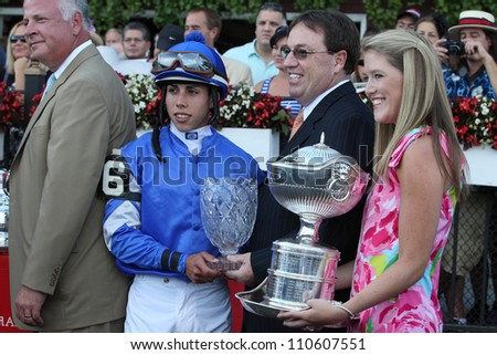 SARATOGA SPRINGS, NY - AUGUST 18: Winning connections in the winners circle for the Grade I Alabama Stakes on August 18, 2012 in Saratoga Springs, NY