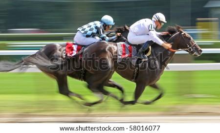 SARATOGA SPRINGS, NY - JUL 24: Jockey Garrett Gomez pilots Keep Me Informed to his first win at Saratoga Race Course on Jul 24, 2010 in Saratoga Springs, NY.
