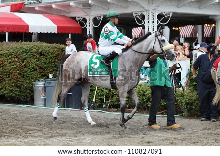 SARATOGA SPRINGS, NY - JULY 28: Jockey Javier Castellano aboard Winter Memories leaves the paddock for the post parade of The Diana Stakes on July 28, 2012 Saratoga Springs, New York