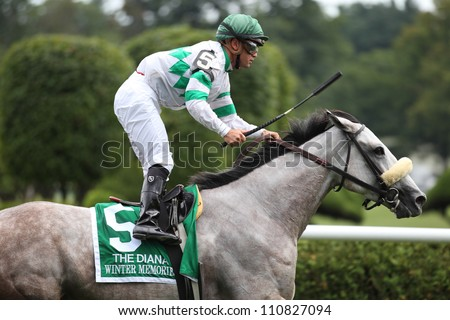 SARATOGA SPRINGS, NY - JULY 28: Jockey Javier Castellano aboard Winter Memories rides out after winning The Diana Stakes on July 28, 2012 Saratoga Springs, New York