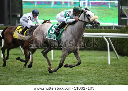SARATOGA SPRINGS, NY - JULY 28: Jockey Javier Castellano aboard Winter Memories wins The Diana Stakes on July 28, 2012 Saratoga Springs, New York