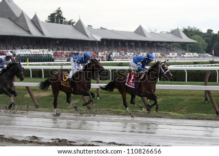 SARATOGA SPRINGS, NY - JULY 28: Jockey Ramon Dominguez aboard Alpha leads the field in the clubhouse turn during the Jim Dandy Stakes on July 28, 2012 Saratoga Springs, New York