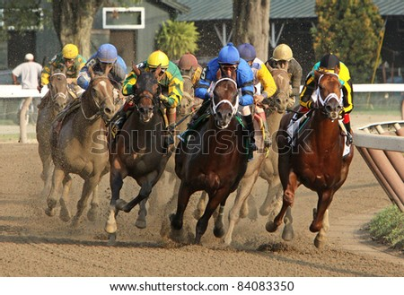 SARATOGA SPRINGS, NY -SEPT 3: Jackson Bend (Corey Nakatani up, maroon cap) emerges from the pack to win The Forego Stakes at Saratoga Race Course on Sept 4, 2011 in Saratoga Springs, NY. - stock photo