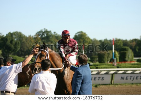 SARATOGA SPRINGS - September 1: Hostess with Rajiv Maragh Aboard is Greeted Outside of the Winners Circle after the Grade III Glens Falls Stakes on September 1, 2008 in Saratoga Springs, NY