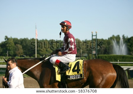 SARATOGA SPRINGS - September 1: Hostess with Rajiv Maragh Aboard is Greeted Outside the Winners Circle after the Grade III Glens Falls Stakes on September 1, 2008 in Saratoga Springs, NY