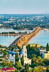 Saratov bridge between Saratov and Engels across the Volga river and the Pentecost Cathedral of Saratov in Russia