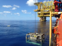 SARAWAK, MALAYSIA - JUNE 16th, 2017: Unidentified offshore crews was monitored ROV during recovering ROV to DMS.