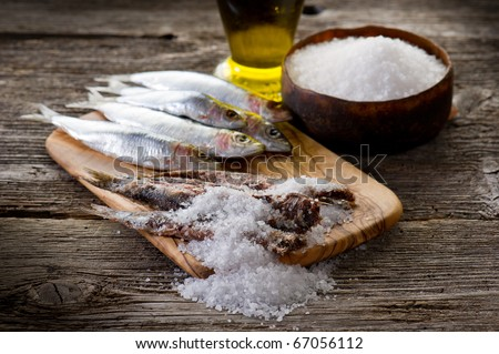 sardines with salt on wood background