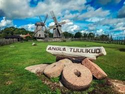 Sarema windmill village. Old wooden windmills in Estonia. Dark windmills. The town of Angla Tuulikud. Tourist attraction in Estonia.