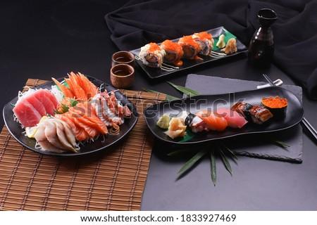Sashimi and sushi Japanese food set. Salmon, Ikura, wasabi, fish, shrimp and tuna in a Japanese restaurant. Foto d'archivio ©