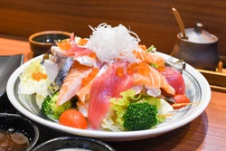 Sashimi salad ( kaizen salad ) with salmon tuna and ikura salmon roe closeup shot with  macro lens