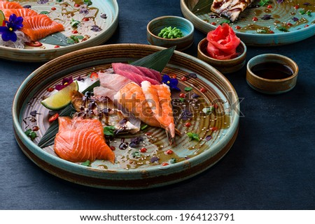 Sashimi set, Japanese food sashimi a traditional dish of raw fish served on the table with copy space. raw sliced fish Foto d'archivio ©
