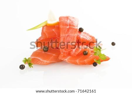 Sashimi sushi. Raw salmon pieces arranged on white background.