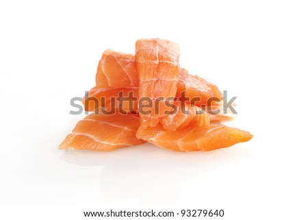 Sashimi sushi. Raw salmon pieces arranged on white background.