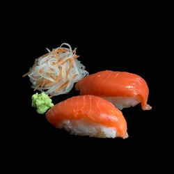 Sashimi Sushi set with salmon, wasabi and shredded radish are on the black background. Selective focus. Isolated picture.