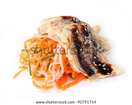 sashimi tamago with sauced slices of japanese omlet on white dish