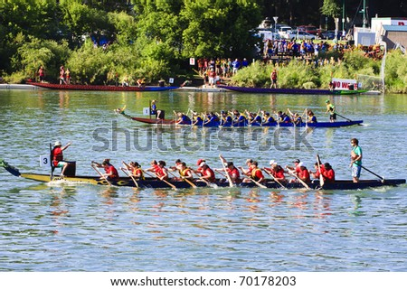 SASKATOON - JULY 24: Athletes fight hard for victory and had fun at the dragon boat racing festival July 24, 2010 in Saskatoon, Canada.