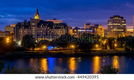 Saskatoon skyline at night along the Saskatchewan River.  #449420395
