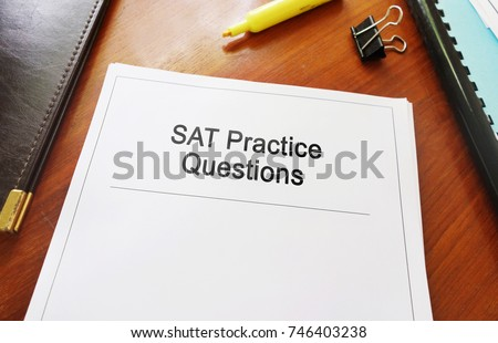 SAT Practice Questions study guide on a desk