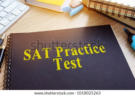 SAT Practice Tests with textbooks on a desk.