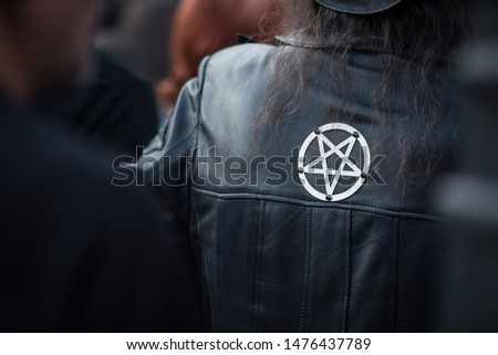 Satanic pentagram sign on a leather jacket at rock festival