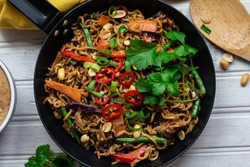 Satay noodles with vegetables. Satay sauce