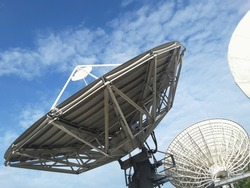 Satelite dishes in the blue sky.