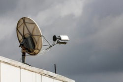 Satelite is attached on the roof of a panel residential building