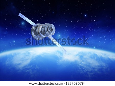 satellite above earth in the sky #1527090794