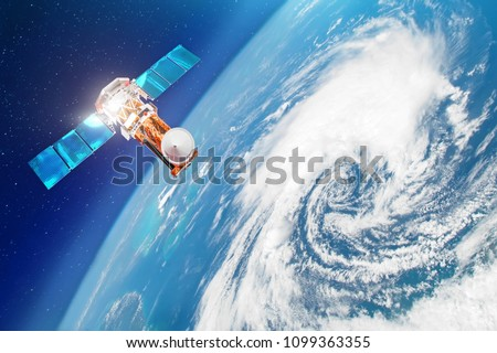 Stock Photo Satellite above the Earth makes measurements of the weather parameters. Research, probing, monitoring of tracking in a tropical storm zone, a hurricane. Elements of this image furnished by NASA