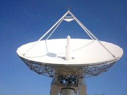 Satellite control antenna under cloudless blue sky