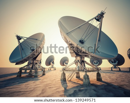 Satellite dish array at sunrise.