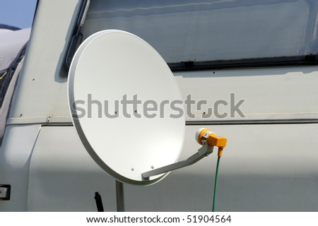 Satellite Dish in front of a caravan