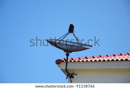 Satellite dish mounted under roof