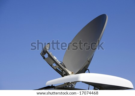 satellite dish on a radio and tv truck